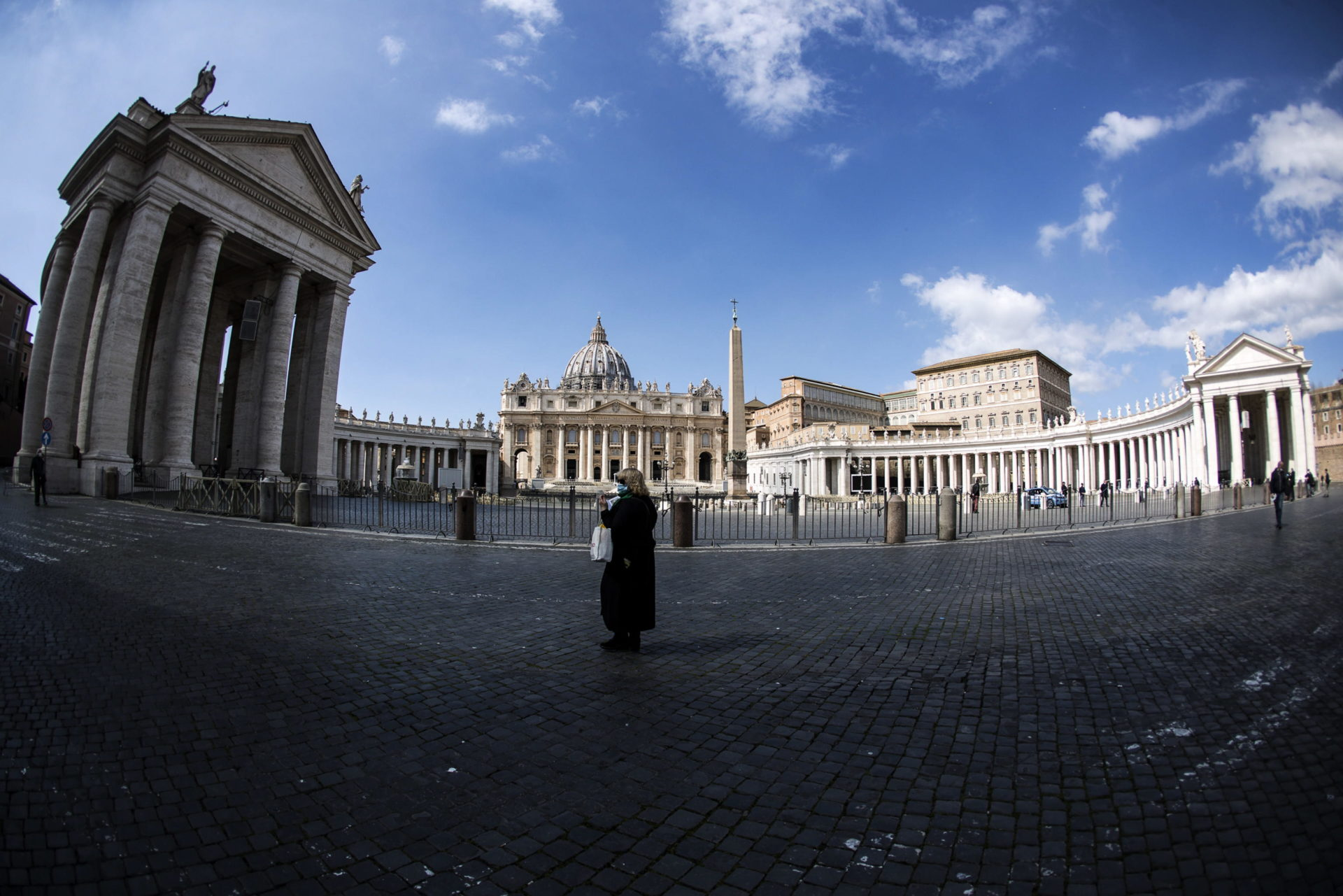 epaselect epa08295732 A faithful prays during Angelus Prayer in St. Peter Square in Vatican, in Rome, Italy, 15 March 2020. In cooperation with Italian emergency measures, the Vatican has closed St. Peter's Square and Basilica starting 10 March 2020 till 03 April 2020. During the prayer Pope Francis prayed for the sick, the medical staff and the volunteers. Italy has 21,157 covid-19 cases.  EPA/ANGELO CARCONI