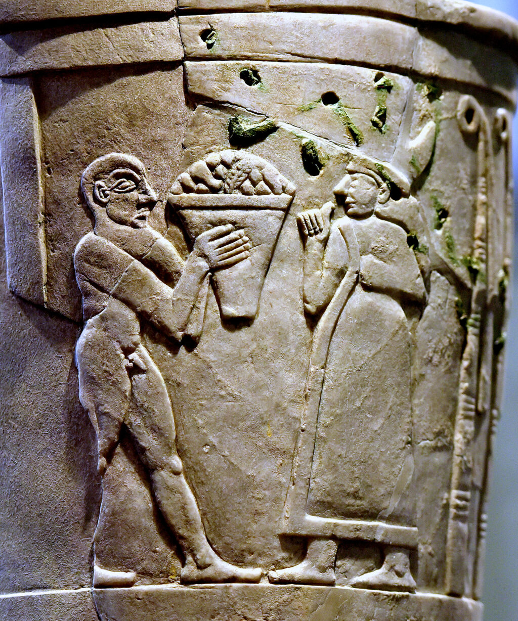 Inanna_receiving_offerings_on_the_Uruk_Vase,_circa_3200-3000_BCE